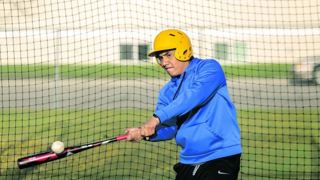 Ankrik Moreno, 13, connects with the ball in the batting cages at practice on Tuesday. The team works hard to get ready for games that start next week.
