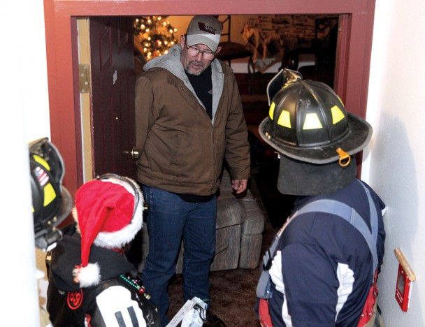 Firefighters & bikers deliver gifts to